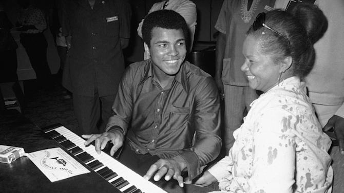 In this Sept. 22,  1974, photo, Muhammad Ali plays a few notes on the piano as singer Etta James looks on.   The singer's manager says Etta James has died in Southern California.   Lupe De Leon tells The Associated Press the singer died early Friday, Jan. 20, 2012 at Riverside Community Hospital.  De Leon says the cause of death is complications of leukemia. (AP Photo/Horst Faas)