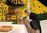 Japanese Emperor Akihito and Empress Michiko offer a silent prayer during an annual memorial service to honour the dead on the 67th anniversary of Japan's surrender from World War II in Tokyo. China and South Korea have pressed Japan to face up to its wartime past, as festering territorial disputes flared and Asia marked the anniversary of Tokyo's World War II surrender