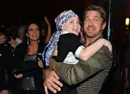 Actors Abella Wyss (L) and Gerard Butler arrive at the special Children's Hospital Los Angeles' Benefit screening of 'Playing For Keeps' at ArcLight Hollywood, on November 28, in Hollywood, California