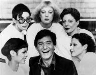 Hairstylist Vidal Sassoon is surrounded by models, showing his new cuts for 1976, in London, on Jan.23, 1976. The styles are called, clockwise from lower left; The Hummingbird, Question Mark, Feathers, Tomboy and Silver Lady. (AP Photo)