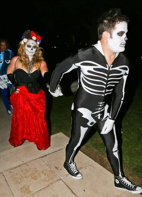 Hilary Duff and hubby Mike Comrie were happy to indulge in more than a little face paint as part of their spooky Day of the Dead skeleton costumes. The couple left 7-month-old baby Luca with a sitter
