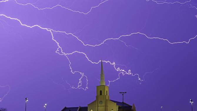 Lightning steaks across the sky behind the Young Meadows Presbyterian Church in Montgomery, Ala., Monday, March 18, 2013. Strong storms moved across much of Alabama on Monday, bringing hail, high winds, and heavy rainfall as a cold front passed through the state. (AP Photo/Dave Martin)