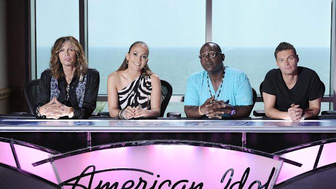 """In this image released by Fox, from left, Steven Tyler, Jennifer Lopez, Randy Jackson and Ryan Seacrest answer questions from the press on the set of """"American Idol"""" auditions in Galveston, Texas. The popular singing competition premiers Wednesday, Jan. 18, 2012 on Fox. (AP Photo/FOX, Michael Becker)"""