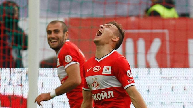 Spartak's Sergei Parshivlyuk, right, celebrates his goal during a Russian Premier League Championship soccer match between CSKA Moscow and Spartak Moscow at the Lokomotiv stadium in Moscow, Russia, Sunday, Sept. 22, 2013. Spartak won 3-0
