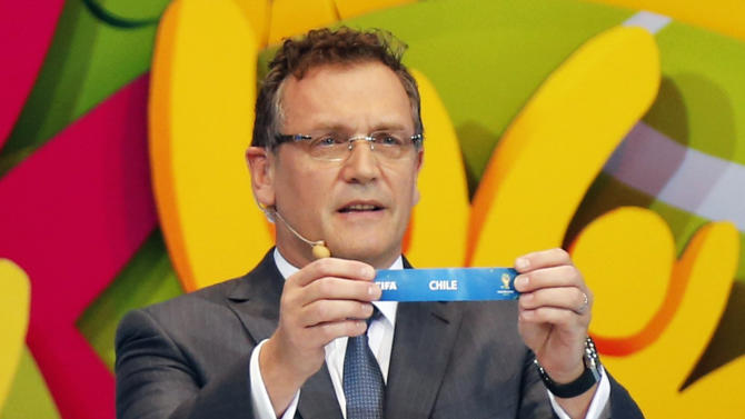 """FIFA Secretary General Jerome Valcke holds the slip showing """"Chile"""" during the draw for the 2014 World Cup at the Costa do Sauipe resort in Sao Joao da Mata"""