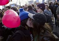 "A lesbian couple kiss on Bastille square, in Paris on December 16, 2012 during a demonstration for the legalisation of gay marriage and LGBT (lesbian, gay, bisexual, and transgender) parenting. Pope Benedict XVI on Friday weighed in on a heated debate over gay marriage, saying same-sex unions called into question what it means to be ""true men"""