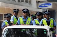 File photo of Maldivian police on patrol in the capital of Male. A court in the Maldives has ordered a public flogging for a 16-year-old girl who confessed to having pre-marital sex, defying UN pressure to drop corporal punishment of women, officials said Tuesday