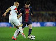 """Barcelona's Lionel Messi (R) and PSG's Alex Costa are pictured during their Champions League match on April 10, 2013. """"Messi was the catalyst. We changed after he came on and we have to thank him for that,"""" teammate Pedro Rodriguez said"""