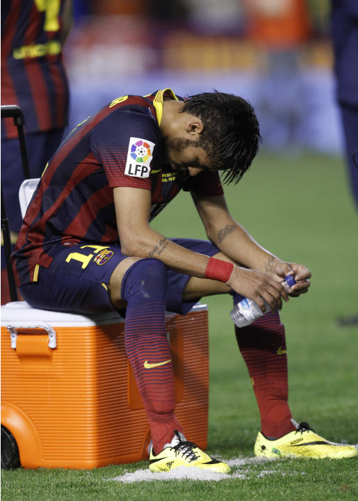Barcelona's Neymar sits after Real Madrid won the final of the Copa del Rey between FC Barcelona and Real Madrid at the Mestalla stadium in Valencia, Spain, Wednesday, April 16, 2014. (AP Photo/Al
