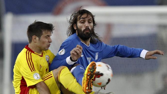 Romania's Alexandru Matel challenges Greece's Giorgos Samaras during their 2014 World Cup qualifying playoff first leg soccer match at Karaiskaki stadium in Piraeus, near Athens