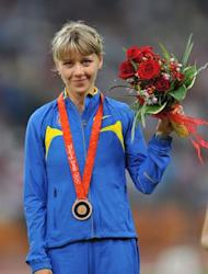 Ukraine's Nataliya Tobias poses on the podium after taking bronze in the women's 1500m at the National stadium as part of the 2008 Beijing Olympic Games on August 23, 2008. Kenya's Nancy Langat took gold with Ukraine's Iryna Lishchynska in silver and Ukraine's Nataliya Tobias in bronze. AFP PHOTO / FABRICE COFFRINI