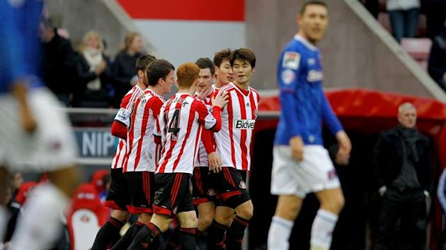 Sunderland's Adam Johnson (centre) celebrates with team mates after scoring Sunderland's opening goal from a free kick during the Third Round - Sunderland v Carlisle United - Stadium of Light (PA Sport)