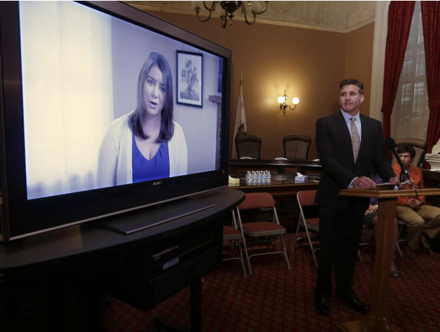 FILE - In this March 25, 2015 file photo, Dan Diaz, the husband of Brittany Maynard, watches a video of his wife, recorded 19 days before her assisted suicide death, where she says that no one should