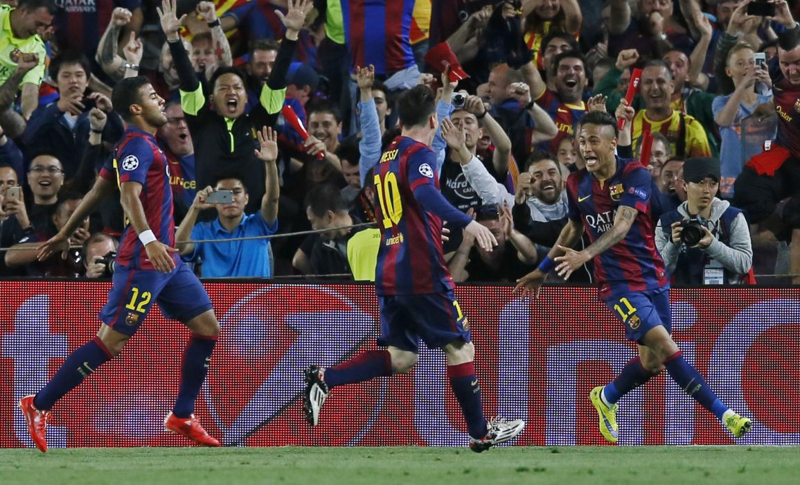 Football: Barcelona's Neymar celebrates scoring their third goal with Lionel Messi and Dani Alves