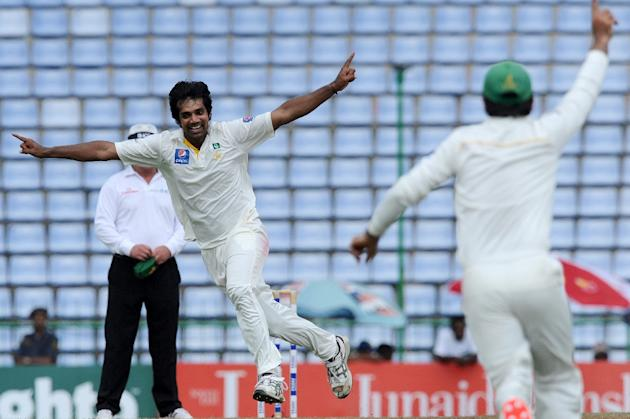 Pakistan's Rahat Ali (L) celebrates with teammates after the dismissal of Sri Lanka's Lahiru Thirimanne during the third day of the third and final Test in Pallekele on July 5, 2015