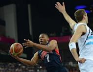 US guard Russell Westbrook reaches the ball during the London 2012 Olympic Games men's semifinal basketball game against Argentina. USA won 109-83