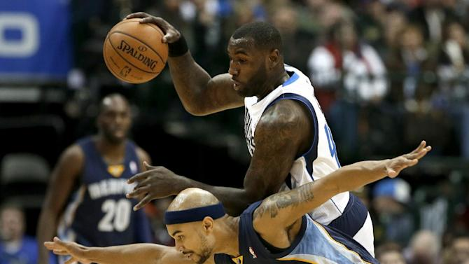 Memphis Grizzlies' Jerryd Bayless (7) blocks Dallas Mavericks' DeJuan Blair (45) from moving the ball upcourt on an offensive possession in the second half of an NBA basketball game on Saturday, Nov. 2, 2013, in Dallas. The Mavericks won 111-99