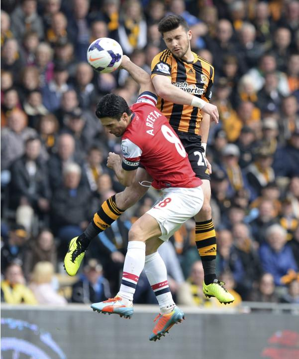 Hull City's Long challenges Arsenal's Arteta during their English Premier League soccer match at the KC Stadium in Hull