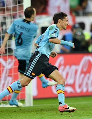 Jesus Navas wheels away after scoring the goal to send Spain through