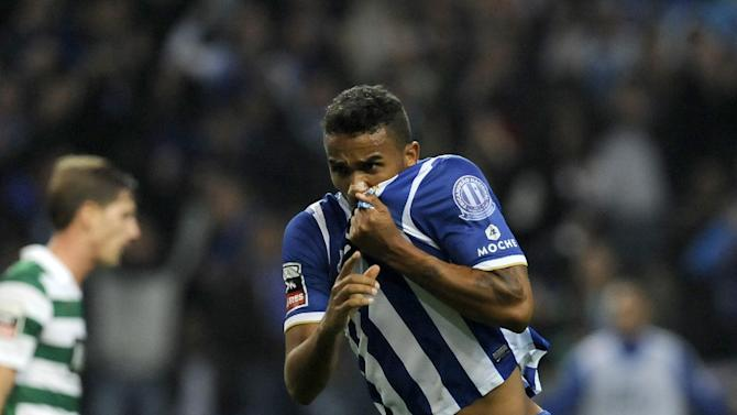 FC Porto's Danilo Silva, from Brazil, celebrates after scoring his side's second goal against Sporting in a Portuguese League soccer match at the Dragao stadium in Porto, Portugal, Sunday, Oct. 27, 2013