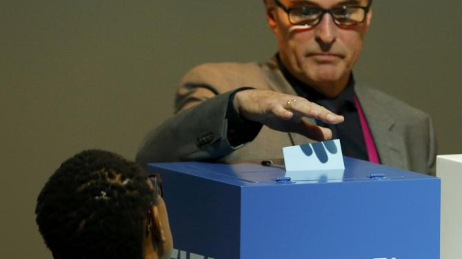 The delegate of Germany  casts the ballot of his association during the voting to decide the organisation's presidency at the 65th FIFA Congress in Zurich