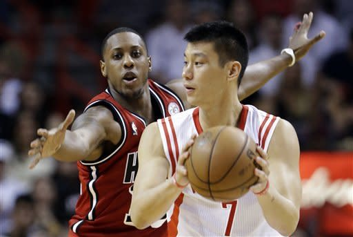 James, Wade score 63, Heat top Rockets 114-108