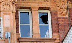 England's Prior is seen in the dressing room near the window that he broke after the second cricket test match between England and Sri Lanka ended in