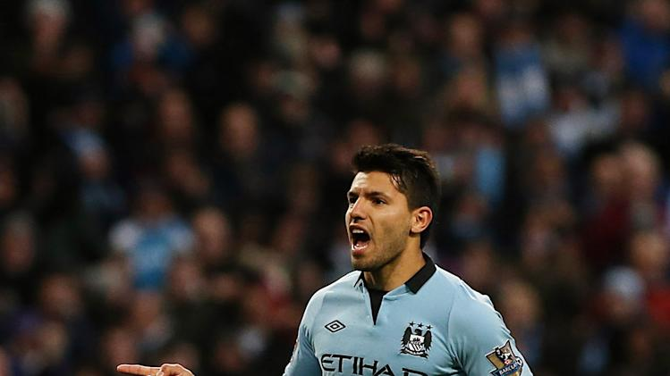 Sergio Aguero celebrates after scoring from the penalty spot