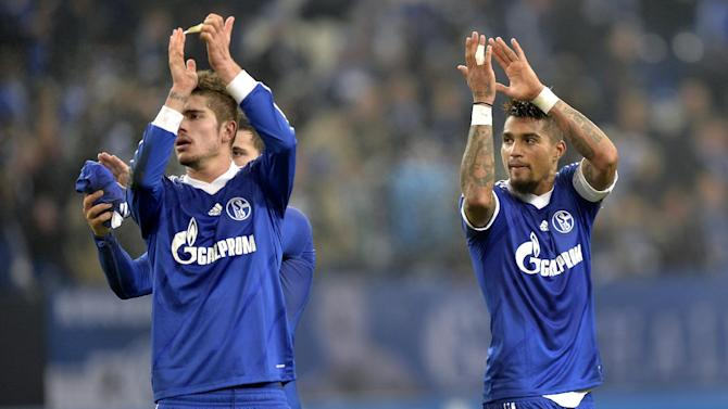 Schalke's Roman Neustaedter, left, and Kevin-Prince Boateng, right, applaud after the Champions League Group E soccer match between FC Schalke 04 and FC Basel in Gelsenkirchen, Germany, Wednesday, Dec. 11, 2013. Schalke defeated Basel by 2-0