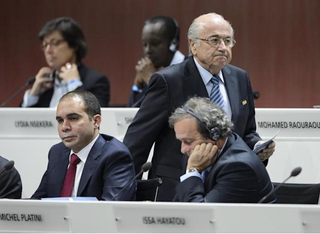 FIFA president Sepp Blatter walks past challenger Prince Ali bin al-Hussein (below, left) and UEFA president Michel Platini (below,right) at the opening of the FIFA congress in Zurich