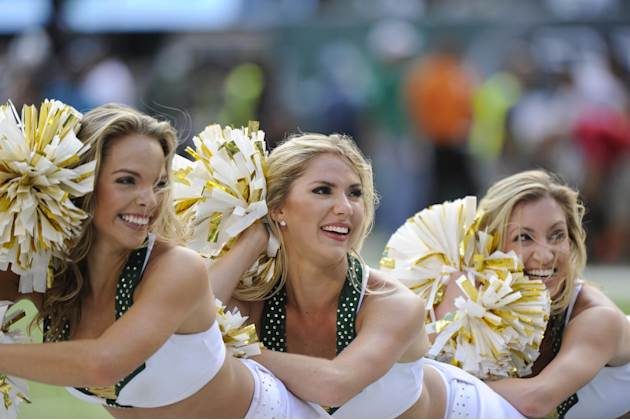 New York Jets cheerleaders perform during the second half of an NFL football game against the Oakland Raiders Sunday, Sept. 7, 2014, in East Rutherford, N.J. (AP Photo/Bill Kostroun)