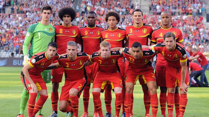 In this June 7, 2013 file photo, Belgium soccer team poses prior to the start the World Cup Group A qualifying soccer match between Belgium and Serbia at the King Baudouin Stadium in Brussels. Foreground from left: Kevin Mirallas, Toby Alderweireld, Kevin De Bruyne, Nacer Chadli, Jan Vertonghen. Background from left: Thibaut Courtois, Marouane Fellaini, Axel Witsel, Daniel Van Buyten, Vincent Kompany. The draw for the 2014 World Cup finals takes place Friday Dec. 6, 2013 near Salvador, Brazil. The 32 teams will be drawn into eight groups of four. The top two in each group will progress to the knockout stages. Twelve stadiums in twelve cities will host matches
