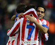 Atletico Madrid players celebrate after scoring a goal during their Spanish La Liga match against Celta de Vigo, at Vicente Calderon stadium in Madrid, on December 21, 2012. Atletico won 1-0
