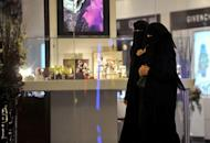 Saudi women walk through a shopping mall in Riyadh. Denied the right to travel without consent from their male guardians and banned from driving, women in Saudi Arabia are now monitored by an electronic system that tracks any cross-border movements