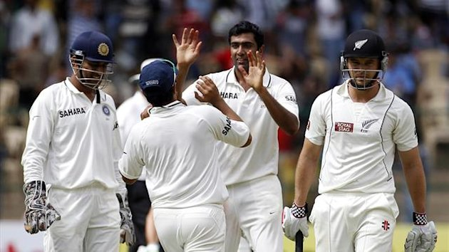 India's Ravichandran Ashwin (2nd R) celebrates taking the wicket of New Zealand's Daniel Flynn (R) with team-mates (Reuters)