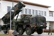 A soldier from the Air Defence Missile Squadron 2 walks past a Patriot missile launcher in Bad Suelze, northern Germany. NATO on Tuesday agreed to deploy Patriot missiles along the border of member state Turkey as requested by Ankara to help it defend its territory against threats from Syria.