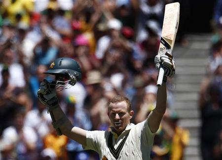 Australia's Chris Rogers celebrates his century during the fourth day of the fourth Ashes cricket test against England at the Melbourne cricket ground December 29, 2013. REUTERS/David Gray