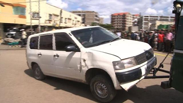 Nairobi police tow away car after overnight bombing
