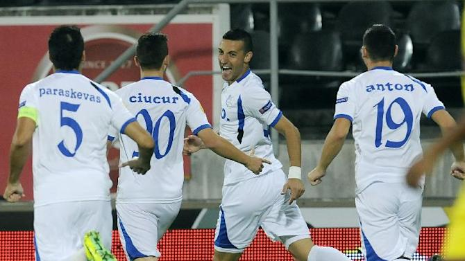 Pandurii's Marko Momcilovic, second right, from Serbia celebrates after scoring against Pacos Ferreira during their Europa League Group E soccer match at the D. Afonso Henriques Stadium, in Guimaraes, Portugal, Thursday Oct. 3, 2013
