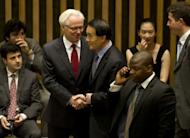Russia's Ambassador to the United Nations Vitaly Churkin (L) and China's Ambassador to the UN Li Baodong speak before a United Nations Security Council vote on Syria. Russia and China on Thursday vetoed a UN Security Council resolution on Syria for the third time, sparking outrage by the Western nations which demanded sanctions against President Bashar al-Assad