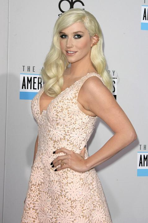 AMAs 2012: Wowzers, we almost didn't recognise Ke$ha here – normally she's wearing torn up tights and hasn't brushed her hair. This cute pink dress and perfectly styled hair is a HUGE improvement. Cop