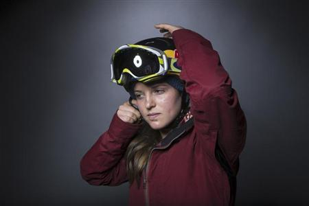 Olympic snowboarder Arielle Gold mimics her pre-run preparation during the 2013 U.S. Olympic Team Media Summit in Park City, Utah
