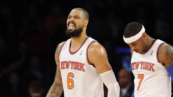 New York Knicks' Tyson Chandler (6) walks off the court with Carmelo Anthony after Chandler injured his leg during the first quarter of an NBA basketball game against the Charlotte Bobcats on Tuesday, Nov. 5, 2013, at Madison Square Garden in New York