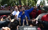 Venezuelan President Hugo Chavez (C) addresses supporters during a campaign rally in Sabaneta, Barinas state. Chavez sang, greeted throngs of supporters and lodged a searing attack on his rival Monday as he stormed into the final stretch of his re-election campaign