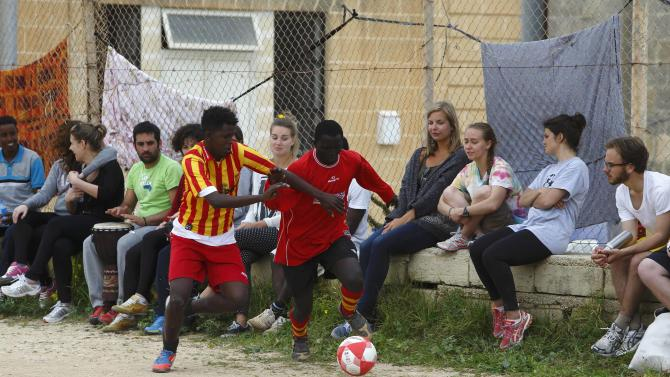 African immigrants take part in a soccer match marking International Day for The Elimination of Racial Discrimination, at the Hal Far open centre for migrants outside Valletta