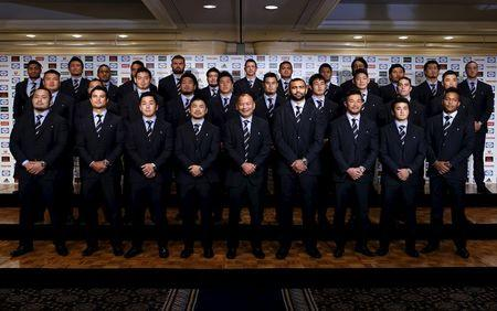 Japan's rugby national team head coach Jones and his squad for upcoming 2015 England Rugby World Cup pose for pictures after the announcement during a news conference in Tokyo