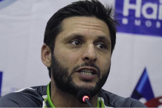 Pakistan's Twenty20 captain Shahid Afridi speaks to reporters at the Gaddafi stadium in Lahore, Pakistan, Thursday, May 21, 2015. With security measures so far holding up, international cricket re