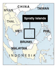 Map locates Spratly islands claimed by China, Taiwan, Vietnam, Malaysia, Brunei and the Philippines.