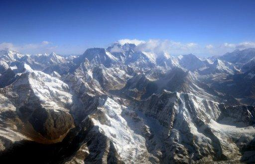 This photograph taken from an aircraft shows an aerial view of Mount Everest (C) and the Himalayan mountain range, north-east of Kathmandu, Nepal, on April 3, 2013. A Saudi woman, Raha Muharraq, on Saturday reached the summit of Everest, the world's highest peak, in a first for the conservative Muslim kingdom where women's sports are severely restricted, her proud father said.