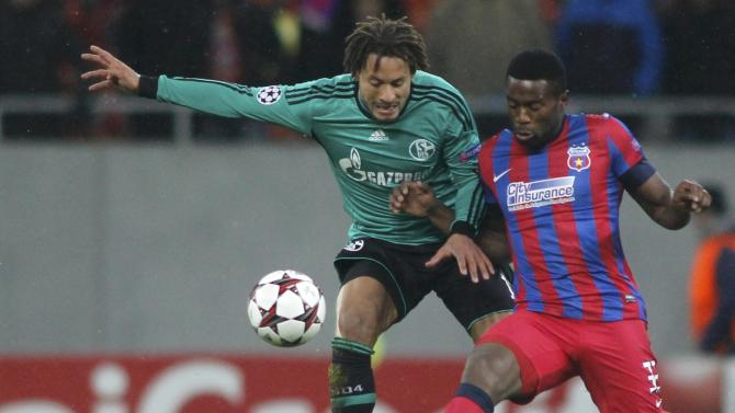 Schalke 04's Jones challenges Steaua Bucharest's Varela during their Champions League soccer match in Bucharest